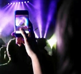 Image of camera phone at concert