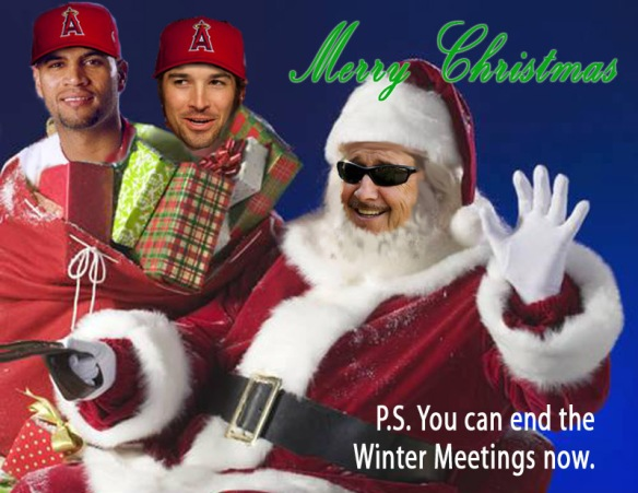 Image of Arte Moreno as Santa Claus with Albert Pujols and CJ Wilson